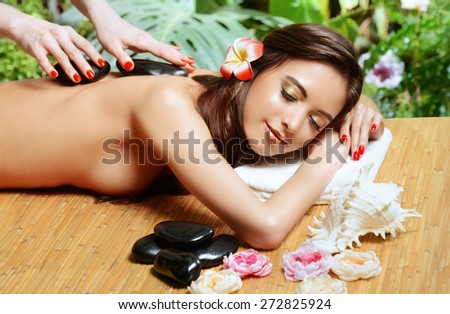 Beautiful young woman getting spa treatments at a beauty salon. Healthcare, body care. - stock photo