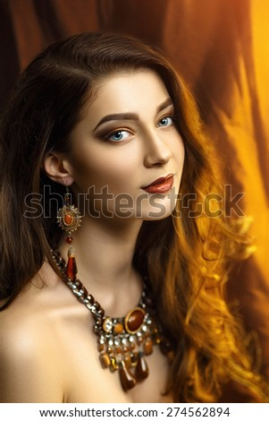 Beautiful young woman, girl, lady, model, actress, wife, mistress. Stylish luxurious look. Expressive makeup, perfect eyebrows, eyes, lips. Color, golden, chocolate, caramel, brown. Chic hair, curls. - stock photo