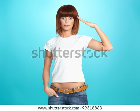 beautiful, young woman giving a military salute, on blue background