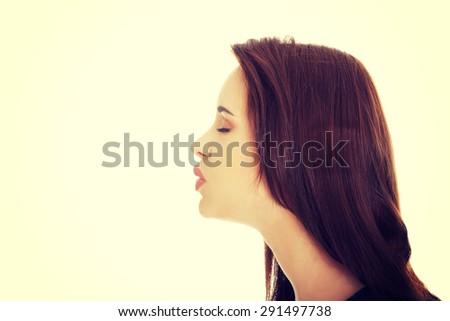 Beautiful young woman giving kiss - stock photo