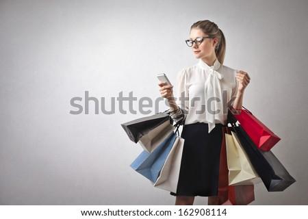 beautiful young woman goes shopping - stock photo