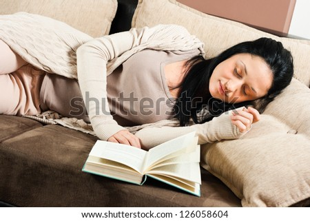 Beautiful young woman had fallen asleep while reading a book,Time for a nap - stock photo