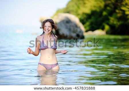 Beautiful young woman having fun in Lake Garda, Italy - stock photo