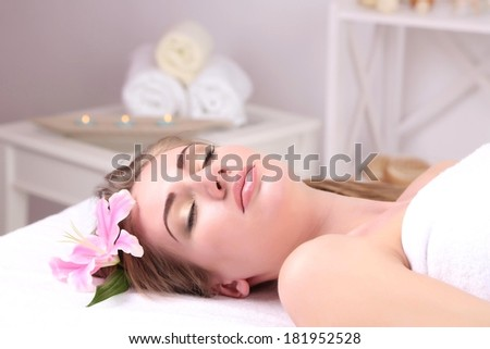 Beautiful young woman having relax in spa salon, close up - stock photo