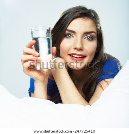 Beautiful young woman hold water glass. Drink water. - stock photo