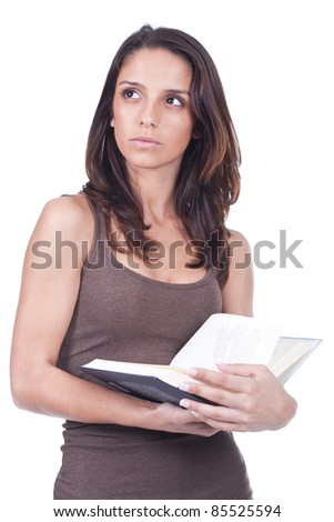beautiful young woman holding a book and thinking - stock photo