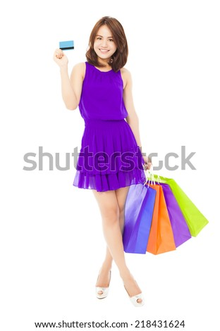 beautiful young woman holding a card and shopping bags. isolated on white background - stock photo