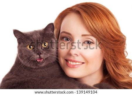 beautiful young woman holding a cat, isolated against white background - stock photo