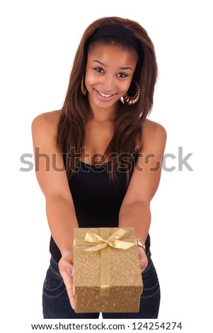 Beautiful young woman holding a gift, isolated on white - stock photo