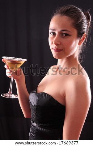 Beautiful young woman holding a martini glass