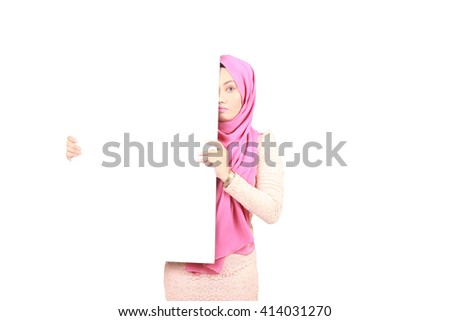 beautiful young woman holding a placard and smiling against a white background, marketing concept - stock photo