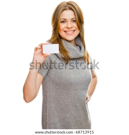 Beautiful young woman holding a small blank card against white background - stock photo