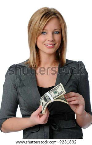 Beautiful young woman holding a stack of money isolated over white