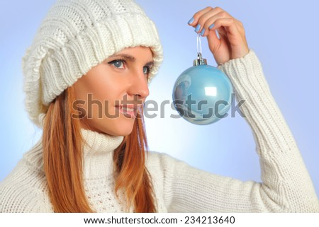 beautiful young woman holding blue ball
