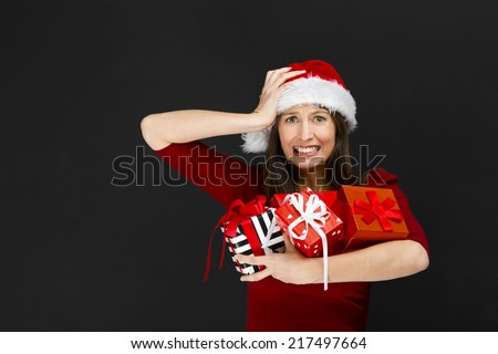 Beautiful young woman holding christmas gifts - stock photo