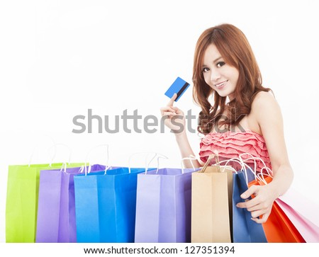 beautiful young woman holding credit card with shopping bags - stock photo