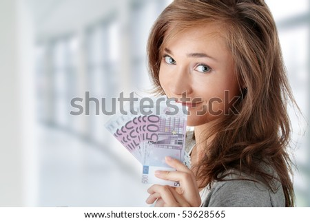 Beautiful young woman holding euros bills - real estate loan concept - stock photo