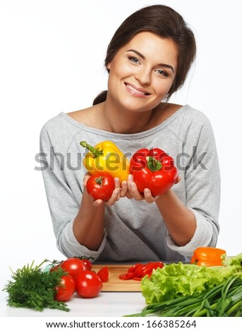 Beautiful young woman holding fresh vegetables