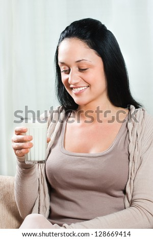 Beautiful young woman holding glass of milk,Healthy refreshment - stock photo