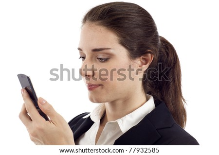 Beautiful young woman holding mobile phone, reading sms message isolated over white background - stock photo
