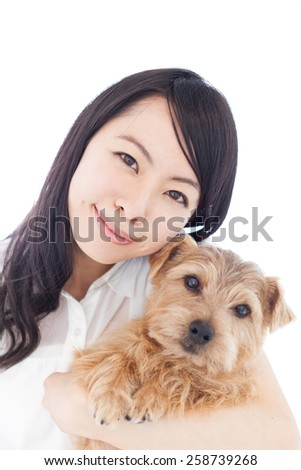 beautiful young woman holding Norfolk Terrier dog, isolated on white background - stock photo