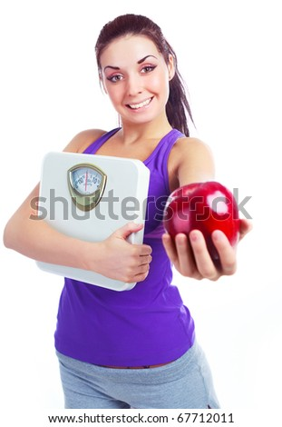 beautiful young woman  holding scales and a red apple