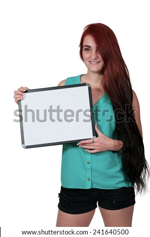 Beautiful young woman holding up a blank sign - stock photo