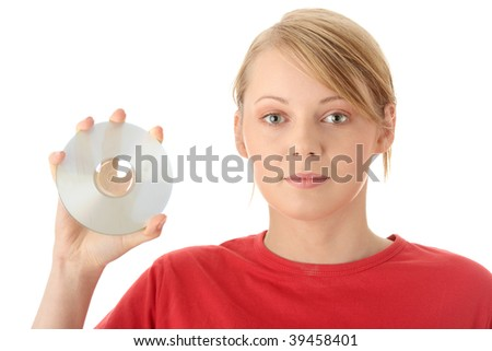 Beautiful young woman holding up a disc (CD, DVD or Blue-ray) against a white background. - stock photo