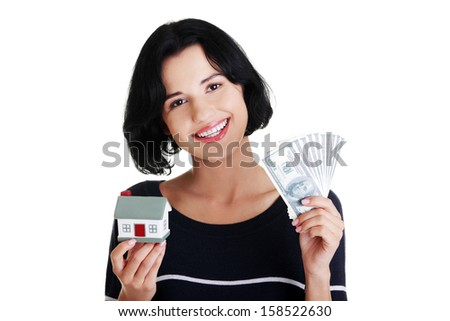 Beautiful young woman holding US dollars bills and house model over white - real estate loan concept  - stock photo