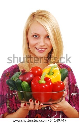 Beautiful young woman holding vegetables isolated on white