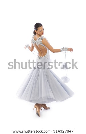 Beautiful young woman in a ballroom dress