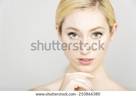 Beautiful young woman in a beauty style pose