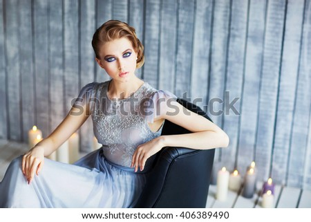 Beautiful young woman in a blue dress - stock photo