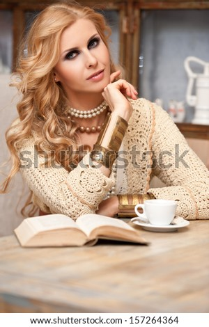 Beautiful young woman in a cafe