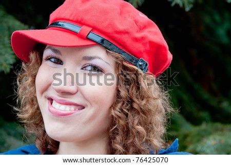 beautiful young woman in a cap of red