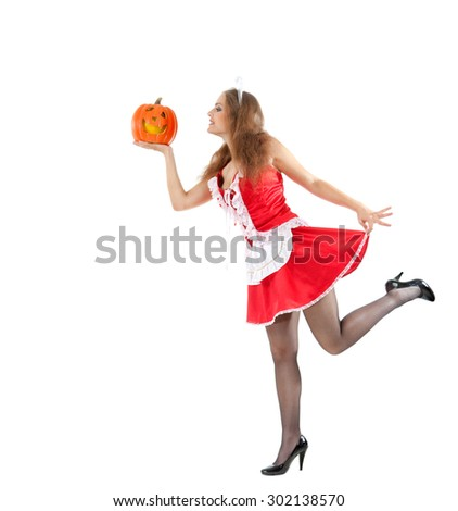 Beautiful young woman in a costume of sexy maid holding halloween pumpkin.