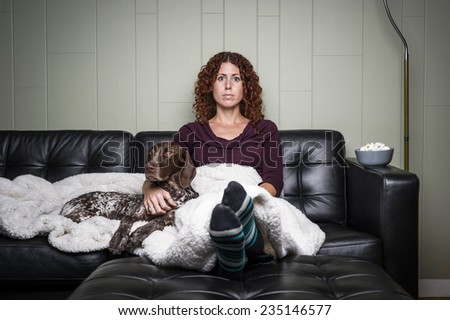 beautiful young woman in a modern living room with a dog