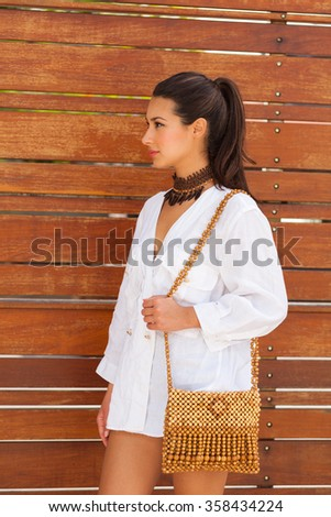Beautiful young woman in a outdoor fashion setting. - stock photo