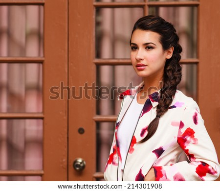Beautiful young woman in a outdoor setting. - stock photo