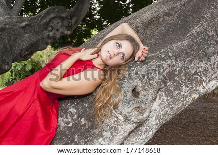 Beautiful Young Woman In A Red Dress. Tenerife. Park Taoro. - stock photo