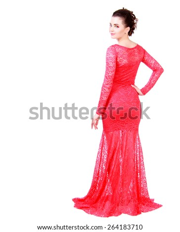 Beautiful young woman in a red evening dress isolated over white background - stock photo