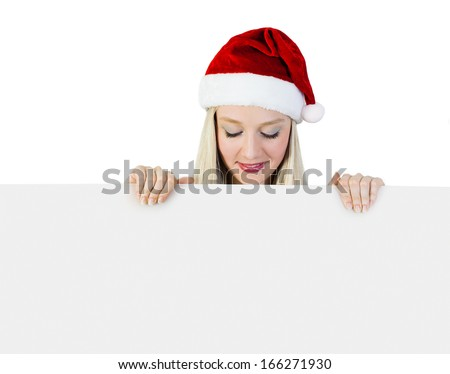 Beautiful Young Woman In a Santa Claus Costume holding a Signboard