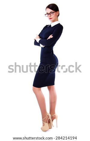 Beautiful young woman in a short blue dress isolated over white background - stock photo