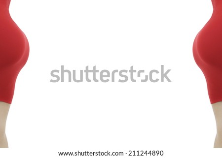 Beautiful young woman in a tight red dress isolated on a white background. Cropped body part. Center space for text - stock photo