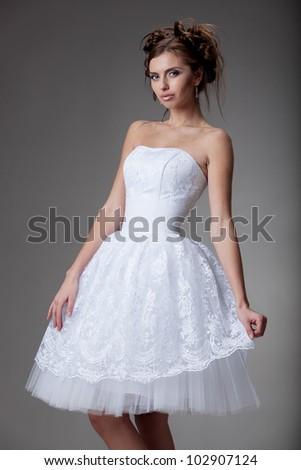 beautiful young woman in a wedding dress - stock photo