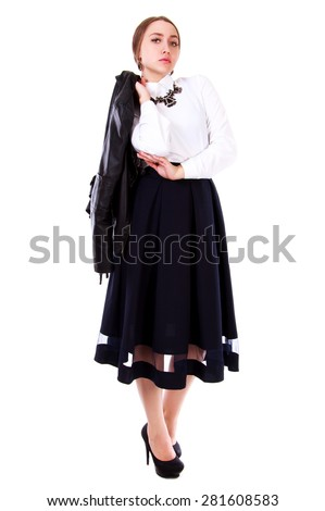 Beautiful young woman in a white blouse and a long black skirt isolated over white background