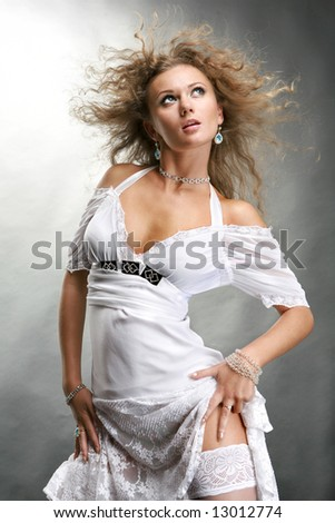 Beautiful Young Woman in a white dress - stock photo