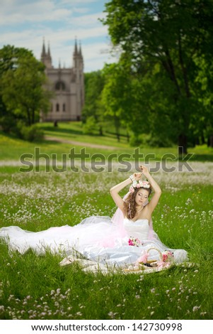 Beautiful young woman in a wreath of flowers like princess - stock photo
