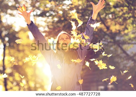 Beautiful young woman in autumn park