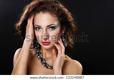 Beautiful young woman in beautiful jewelry